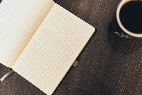 notepad and coffee mug