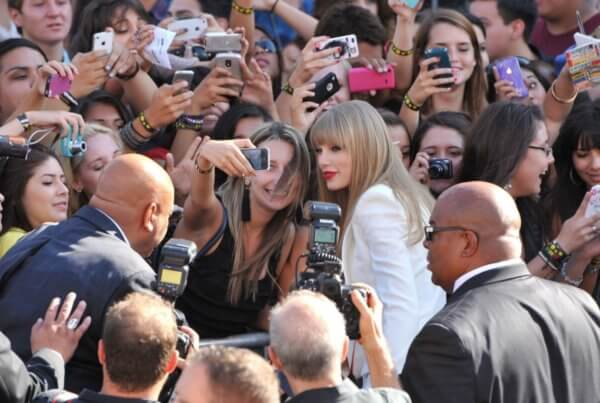 Taylor Swift in crowd taking picture