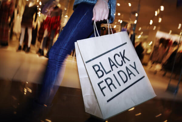 woman carrying bag with black friday written on the side